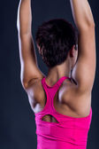 Sporty woman in pink top with beautiful beautiful body closeup — Stock Photo