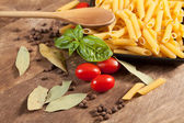 Raw pasta with ingredients. — Stock Photo