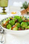 Brussels sprouts with bacon and chestnuts — Stock Photo