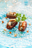 Dates stuffed with blue cheese — Stock Photo