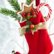 Christmas stocking with gifts — Stock Photo