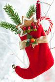 Julstrumpa med gåvor — Stockfoto
