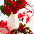 Stock Photo: Roses and chocolate candies for Valentine