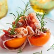 Prosciutto with apricots — Stock Photo