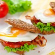 Wholemeal sandwich with fried egg and bacon — Stock Photo #33433353