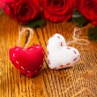 Two hearts and flowers — Stock Photo #35590547