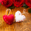 Stock Photo: Two hearts and flowers