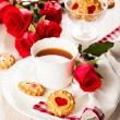 Tea cup with cookies for Valentine's day — Stock Photo
