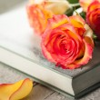 Roses on a book — Stock Photo