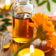 Essential oil,candles and flowers — Stock Photo