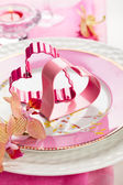 Festive place setting for Valentine's day — Stock Photo