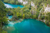 Two big lakes seperated with small waterfalls in Plitvice Lakes — Stock Photo