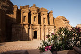 Monastery at Ancient city of Petra with flowers in front, Jordan — Stock Photo