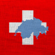 Flag and map of Switzerland on a sackcloth — Stock Photo