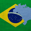 Flag and map of Brazil on a sackcloth — Stock Photo