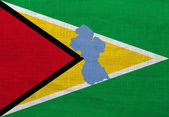 Flag and map of Guyana on a sackcloth — Stock Photo