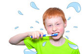 Boy and a toothbrush — Stock Photo