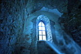Mysterious ancient window — Stock Photo