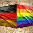 German and Rainbow flags — Stock Photo