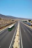 Bus on a highway near the sea coast — Stock Photo