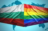 Waving Bulgarian and Gay flags — Stock Photo