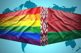 Waving Belarus and Gay flags — Stock Photo