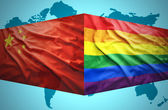 Waving Chinese and Gay flags — Stock Photo