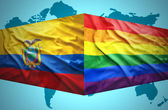 Waving Ecuadoran and Gay flags — Stock Photo