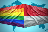 Waving Indonesian and Gay flags — Stock Photo