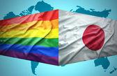 Waving Japanese and Gay flags — Stock Photo