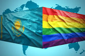 Waving Kazakh and Gay flags — Stock Photo