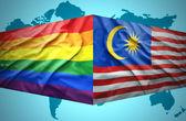 Waving Malaysian and Gay flags — Stock Photo