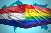 Waving Paraguayan and Gay flags — Stock Photo