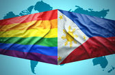 Waving Philippines and Gay flags — Stock Photo
