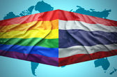 Waving Thai and Gay flags — Stock Photo