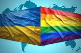 Waving Ukrainian and Gay flags — Stock Photo