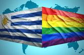 Waving Uruguayan and Gay flags — Stock Photo