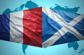 Waving Scottish and French flags — Stock Photo