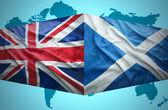 Waving Scottish and British flags — Stock Photo
