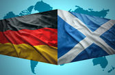 Waving Scottish and German flags — Stock Photo