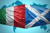Waving Scottish and Italian flags — Stock Photo