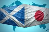Waving Scottish and Japanese flags — Stock Photo