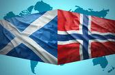 Waving Scottish and Norwegian flags — Stock Photo