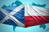 Waving Scottish and Polish flags — Stock Photo
