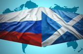 Waving Scottish and Russian flags — Stock Photo