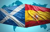 Waving Scottish and Spanish flags — Stock Photo