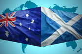 Waving Scottish and Australian flags — Stock Photo