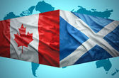 Waving Scottish and Canadian flags — Stock Photo