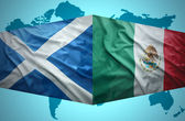 Waving Scottish and Mexican flags — Stock Photo