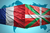 Waving Basque Country and French flags — Stock Photo